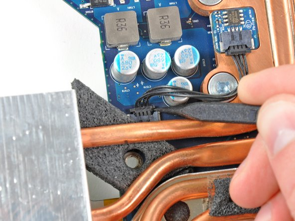 Use the tip of a spudger to push the CPU thermal sensor cable connector out of its socket on the logic board.