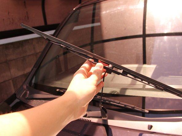 Return the windshield wiper blade back to its original orientation.