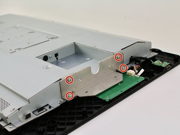 Remove the eight (four on each plate) 10.2mm Phillips #2 screws with locking washers from the metal mounting plates by rotating the screwdriver counterclockwise.