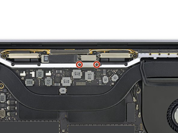 Use a T3 Torx driver to remove the two 3.5 mm screws securing the cover on the display board flex cable.
