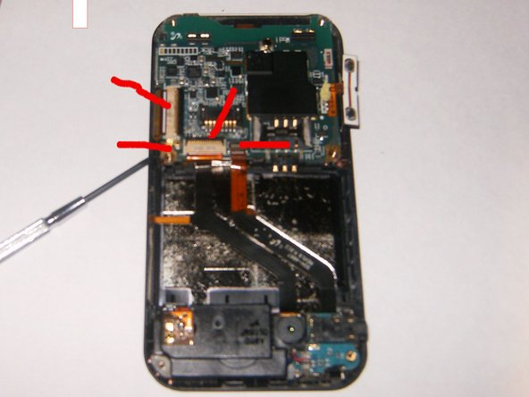 You will now see 4 connectors on the motherboard that need to be removed. You unhook these by carefully lifting up the latch lock (the black bar on the connector) and then slide the cable out. The antenna cable does not have a latch, you remove it by just lifting it up.