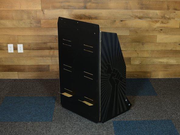 Fit bottom shelf into bottom shelf slots cut into back of display