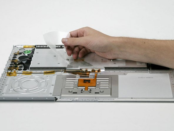 Peel off the adhesive covering the back of the keyboard.