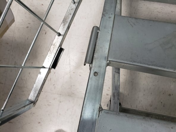 Align the metal rod on the side to the bottom, connecting them both together.