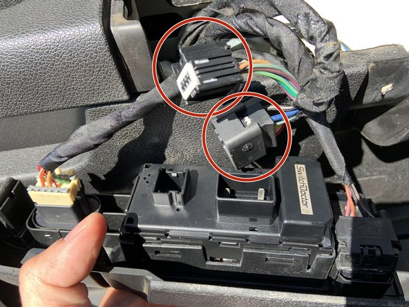 Remove all wire harnesses to the window switches from the back of the panel.
