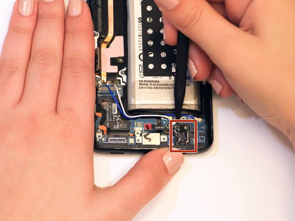 Remove the headphone jack by using a spudger to pry it free.