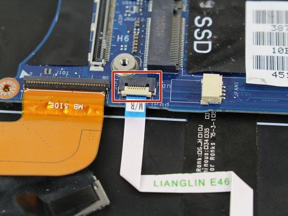 Use tweezers to flip open the white ZIF connector.