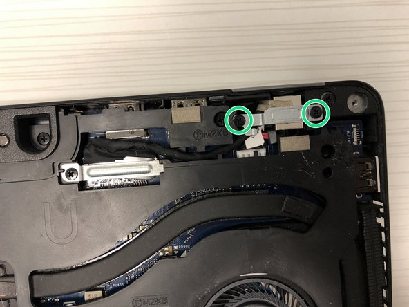 Remove both screws holding the plate in place.