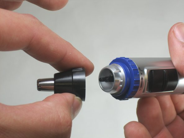 Remove the black trimmer cap from the top of the device by gently pulling it.