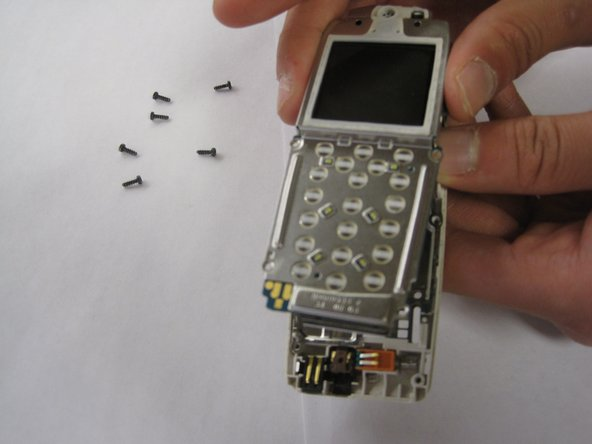 Once all the screws have been removed, the front part of the phone should be removable from the rest of the phone.