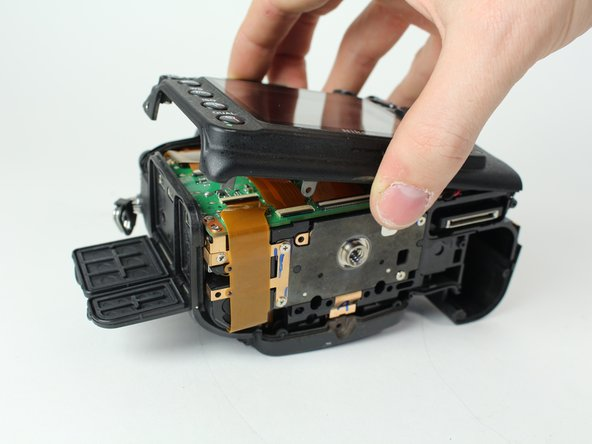 Carefully lift the back case off.