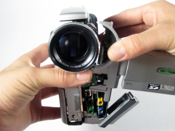 Reorient the camera with the lens facing you.