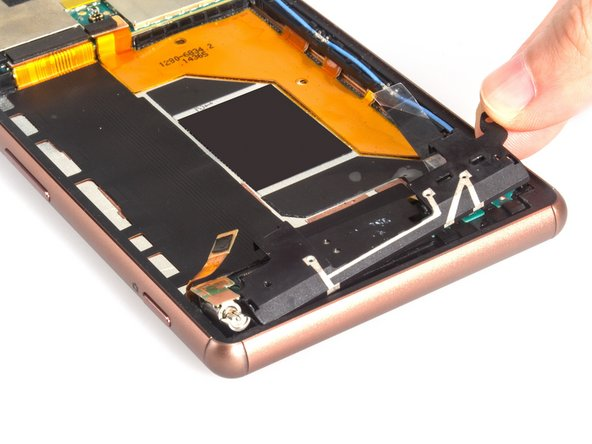 Remove the loudspeaker assembly cover. Tip: pull it toward the centre of the phone as you pull upwards.