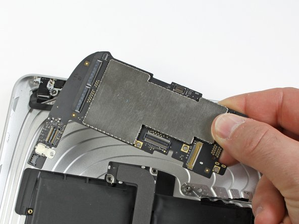 Lift the logic board out of the rear panel assembly.