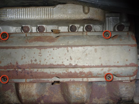 """In order to remove the valve cover, locate the 4 bolts which hold it in place and remove them using a 7/16"""" socket or wrench."""