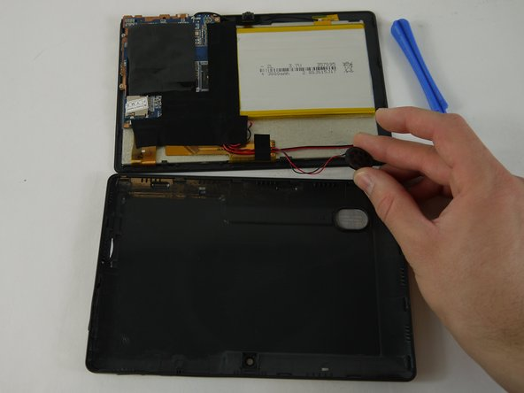 Grip the speaker from the sides with your fingers or a pair of tweezers and slowly begin to remove it from the rear panel.