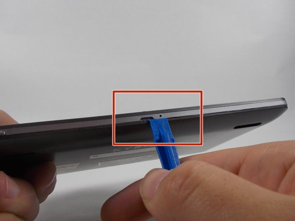 Use iFixit plastic opening tool to make small opening in the side of the device, and continue opening back panel.