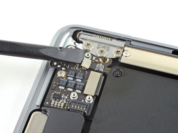 Use the flat end of a spudger to pry the Touch ID cable straight up to disconnect it from the audio board.