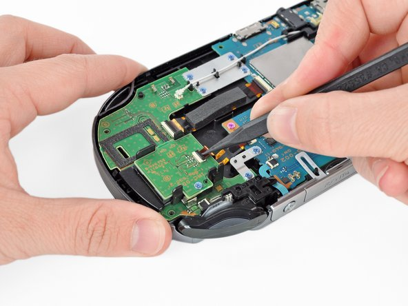 Gently pry open the tab of the flex cable socket on top of the SIM card reader.