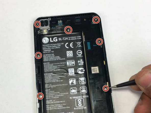 Remove the twelve 2.5mm Phillips #0 screws from the back of the phone.