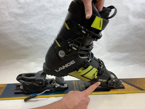 Insert the toe of the boot into the toe piece of the binding.