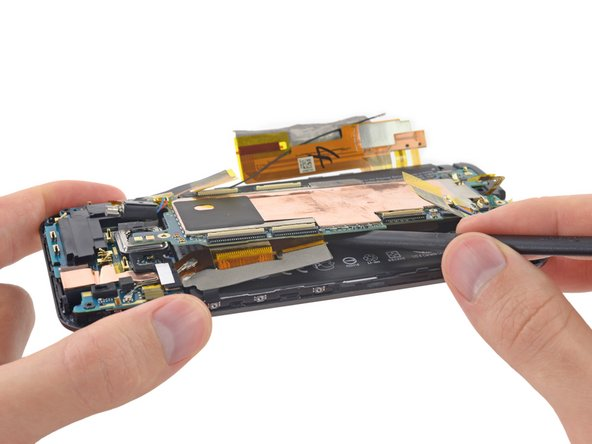 Augh! What is this? Looks like HTC's engineers weren't interested in our input from the M8. They've stuck with their habit of gluing down the motherboard.