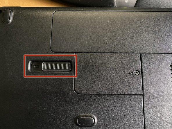 Slide battery latch to left