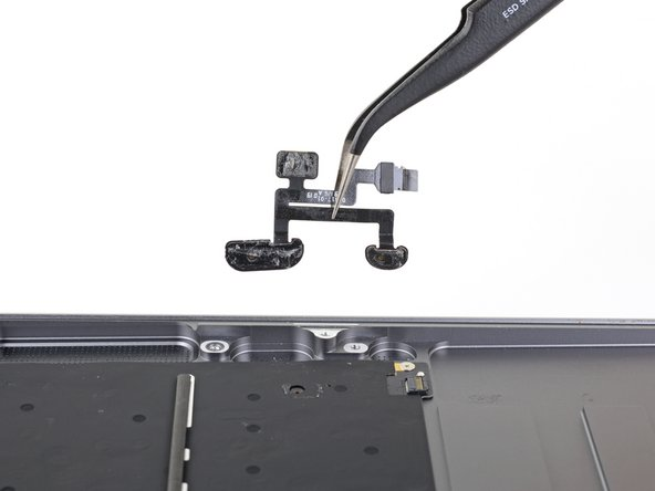 Remove the microphone assembly.
