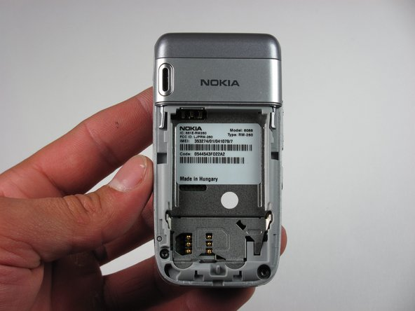 Disassembling Nokia 6086 Upper Back Cover