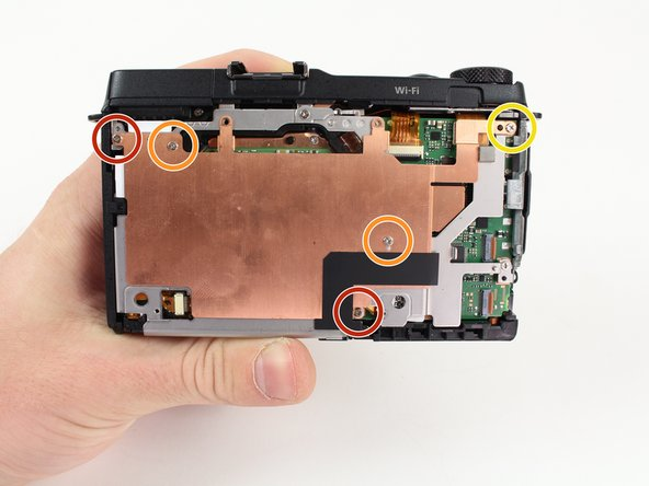 Remove the five Phillips screws that are attached to the copper plate with a Philips Head screwdriver: