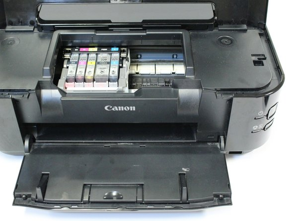 Allow the belt, containing ink cartridges, to adjust and center so that the ink cartridges are visible.