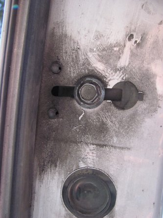 In order to remove the lock actuator with ease, the guide rail for the window nearest the actuator must be moved.