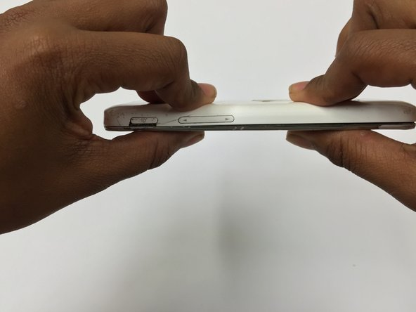 Now put the rear housing cover on the device, starting from its bottom side, and snap the edges all the way around to close the device.