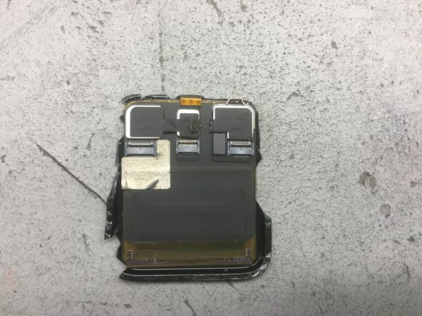 The right-hand module contains the NFC and Light Sensor.  It's attached by some adhesive dots, two solder bumps (for the NFC antenna connection), and some copper tape.