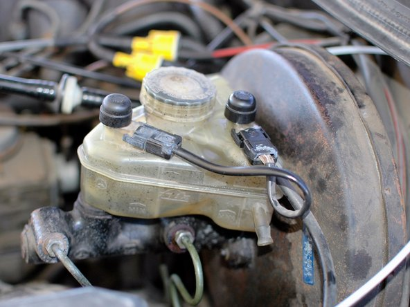 Close up the reservoir. Wipe up any brake fluid that dripped. Check all four bleed screws for any leaks and tighten if needed.