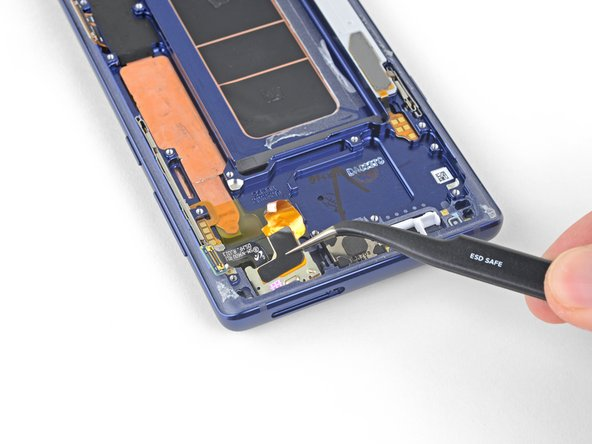 Use a pair of tweezers to remove the front sensor array.