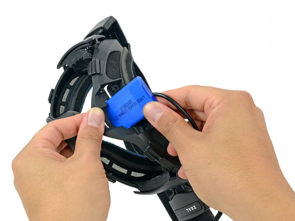 In the same manner described above, remove the battery from the frame.
