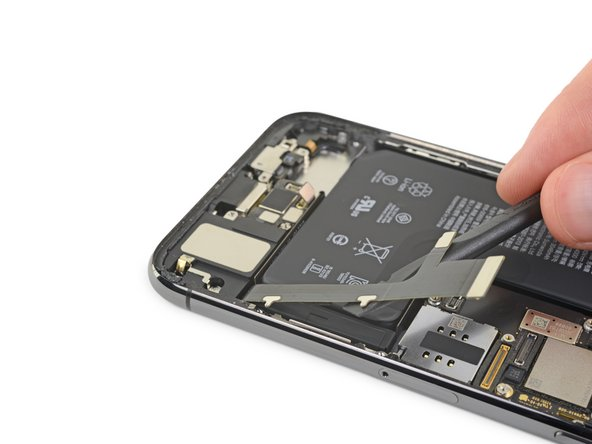 Gently lift the Lightning flex cable and bend it slightly toward the bottom edge of the iPhone for better access to the battery underneath.
