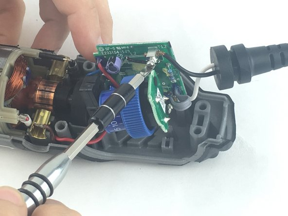 Each wire is fed through a small opening on the circuit board and held with a flat head screw.