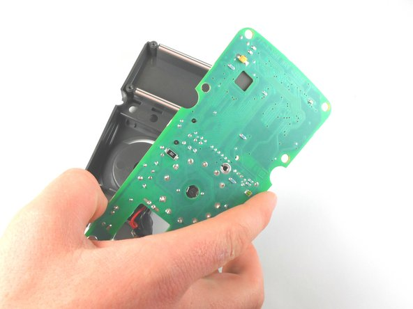 Do not touch any of the chips on the underside of the circuit board because static electricity on your hands could damage them.