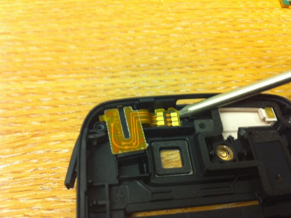 Lifted the connector pin pad of the headphone socket, it is glued on by some adhesive foam.