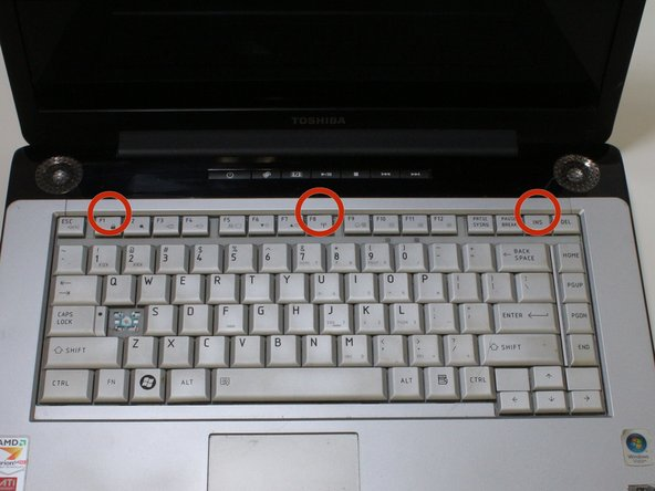 Place laptop right side up on a flat and clean surface. Open the laptop.