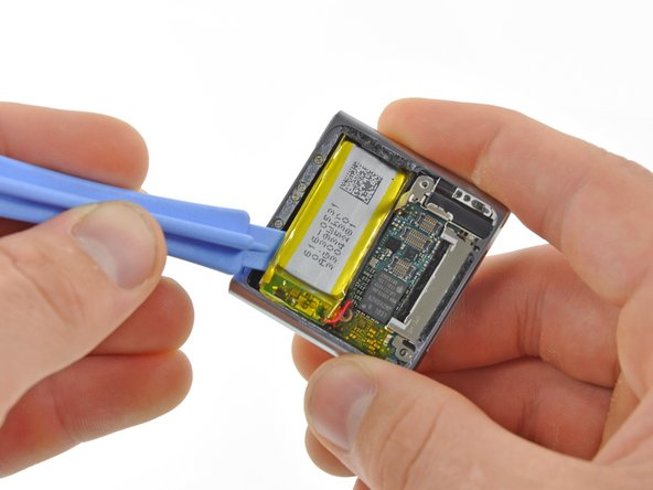 The battery can be pried out of the case with an iPod Nano opening tool, but unfortunately, it is soldered to the logic board.