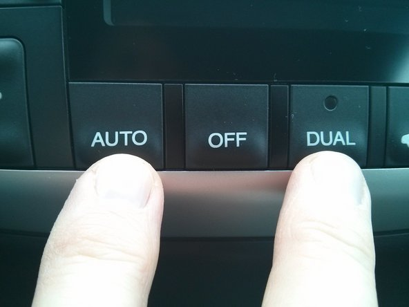 Insert the key in the ignition.