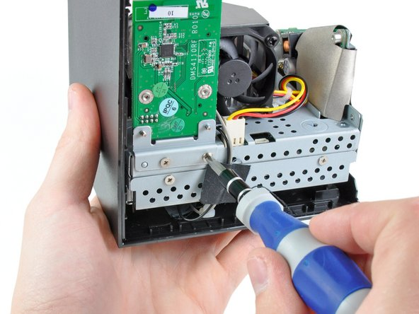 The Boxee Box' wireless board is secured to the metal frame by more Phillips screws.