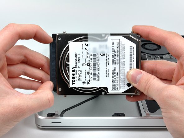 Remove the hard drive cable by pulling the hard drive straight away from the connector. Keep the connector steady. If pulled by the connector, it can be pulled too far and accidentally tear the hard drive cable.
