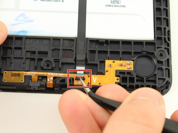 Use the tweezers to flip the switch on the bottom of the strap that goes over the battery.