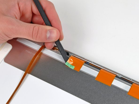 Use the flat end of a spudger to carefully peel the three antenna strips off the lower edge of the LCD.