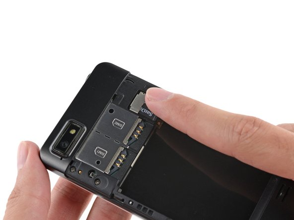 If you have a microSD card, use your finger to slide it straight out of its slot.