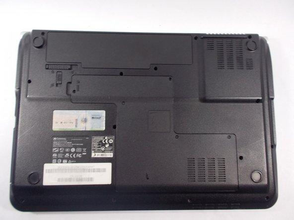 Turn the laptop over so that the underside is facing towards you.